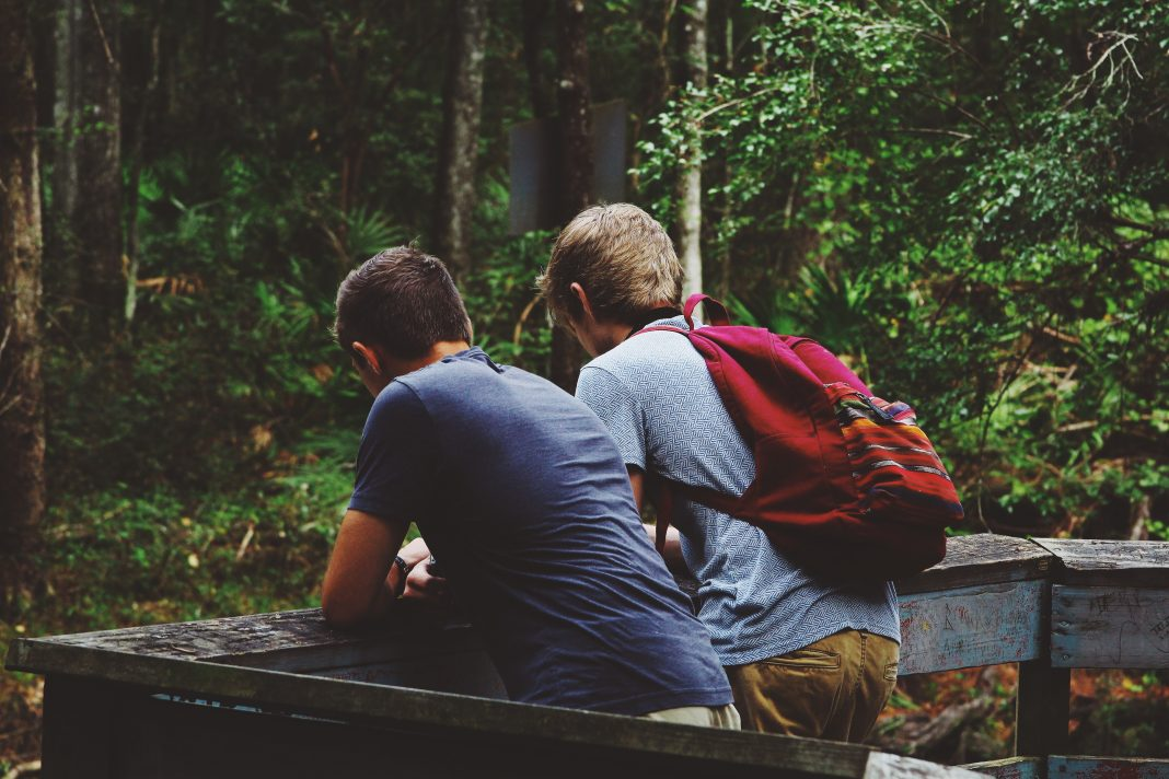 Friends near a forest