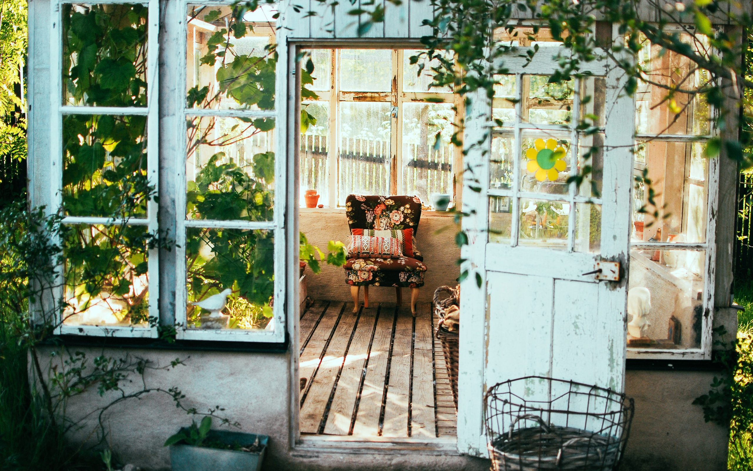 Greenhouse with colorful folding chair