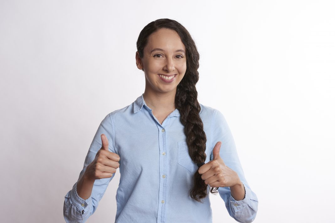 person, thumbs up, smiling