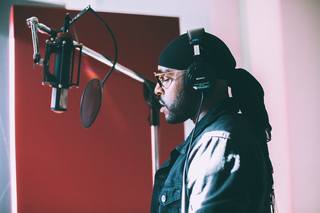 Verse Simmonds vibing while recording vocals