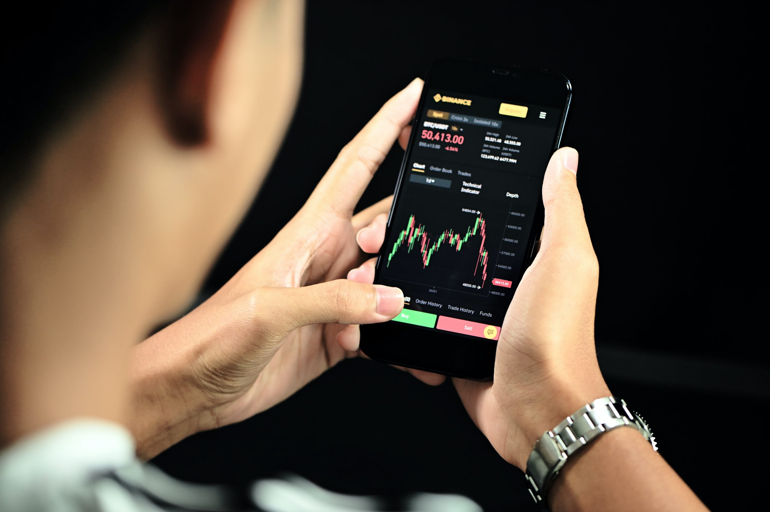 Examining a price chart on the Binance mobile application.