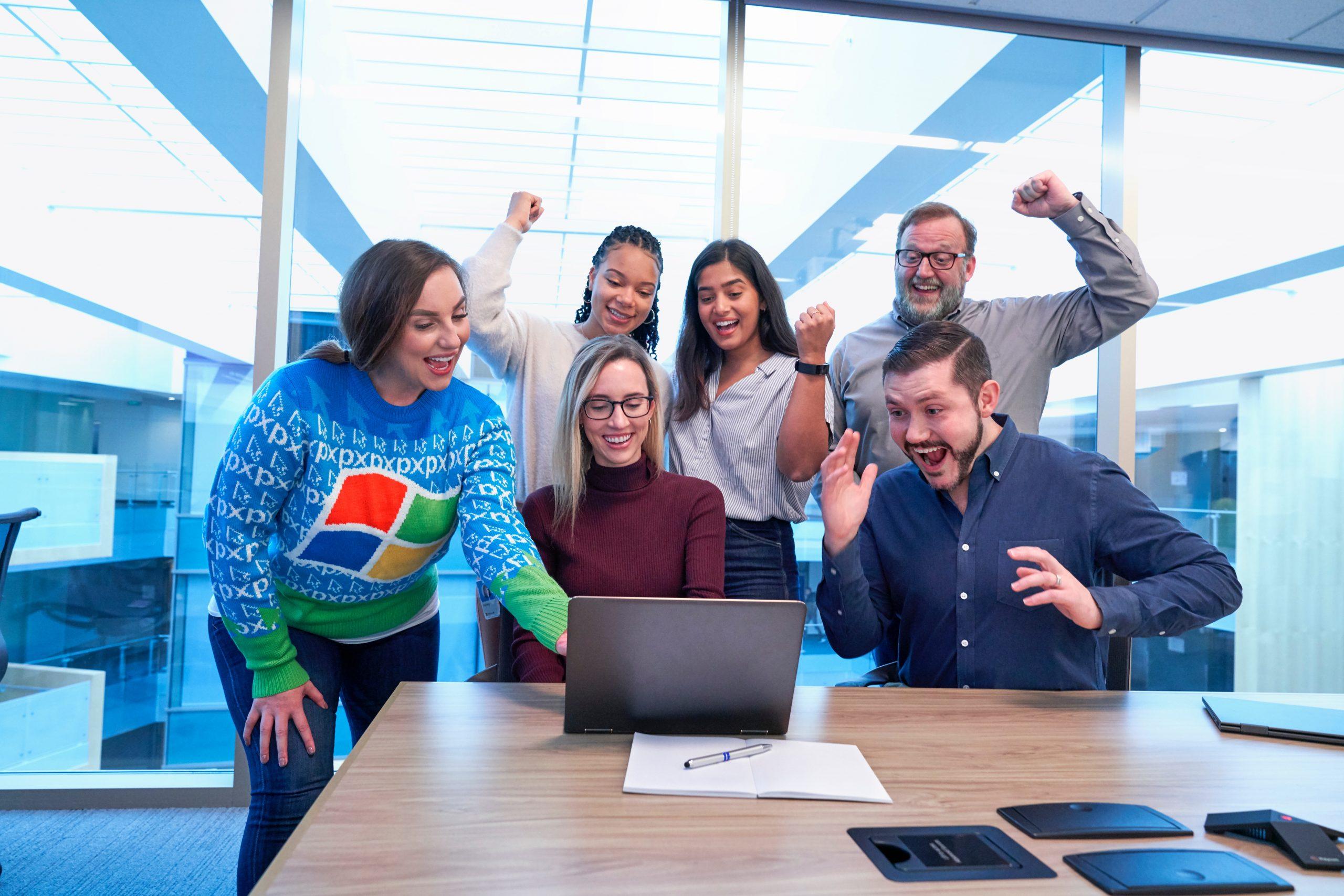 Festive holiday office party in #WindowsUglySweater Softwear by @Windows