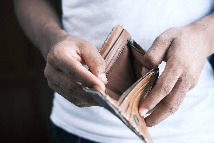 Man hand open an empty wallet with copy space